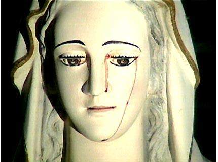 weeping mary statue